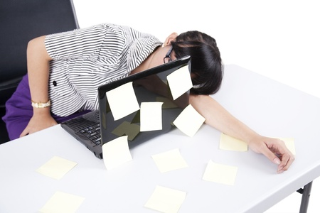 overwork: Tired businesswoman sleeping on her office Stock Photo
