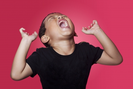 tantrum: Shouting angry asian kid on red background