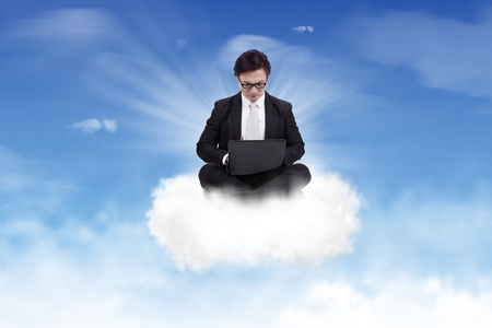 Businessman working on the cloud photo