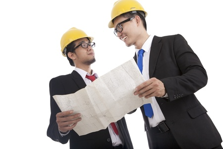 Architect and construction engineer or surveyor discussion plans and blueprints photo