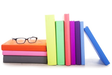 cultural artifacts: Stack of books with glasses - isolated Stock Photo
