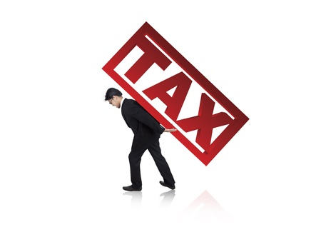 refund: A businessman carry a tax sign on his back isolated on white