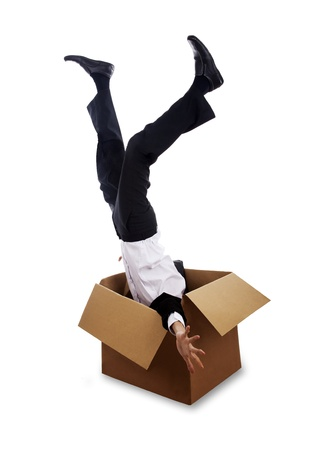 to stumble: Businessman falling down into box isolated on white Stock Photo