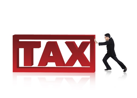Businessman try to push a tax sign  photo
