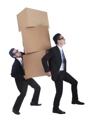 Businessmen carrying stack of boxes photo