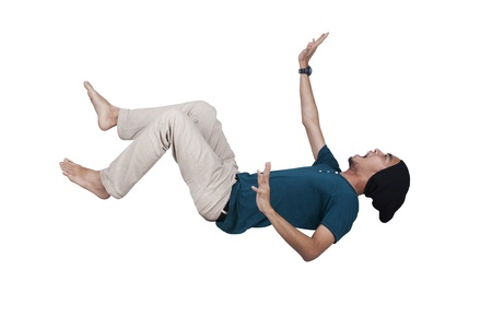 stumble: Man in blue shirt and jeans falling and screaming over white Stock Photo