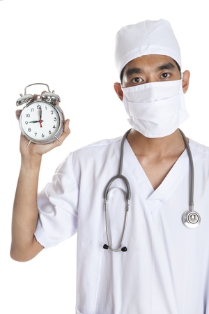 A doctor with alarm clock photo