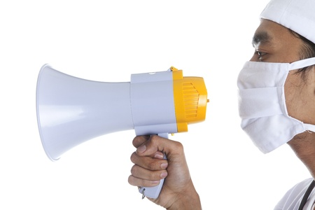A doctor yelling with megaphone over white Stock Photo - 12237500