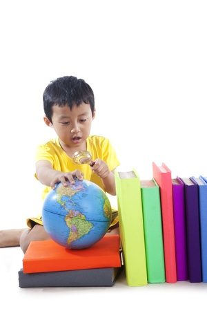 Elementary school student with globe photo