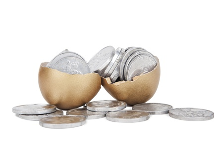 Broken golden eggs with coins on white background photo