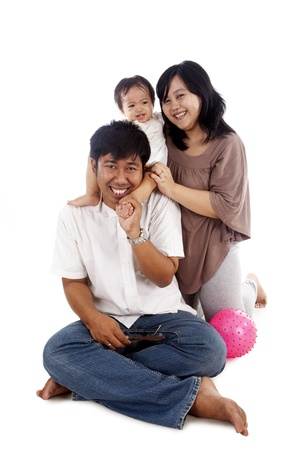 Happy asian family shot in studio isolated on white background photo