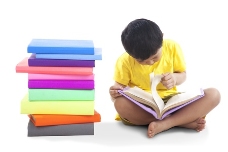 Kid read book isolated on white background photo