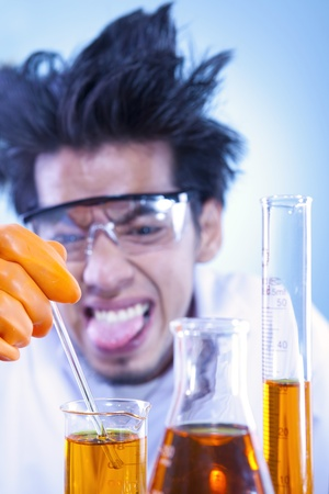 reaction: A mad scientist doing an experiment with sticking out tongue in laboratory