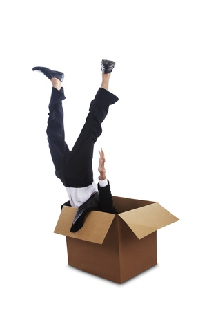 A businessman falling down into a box photo
