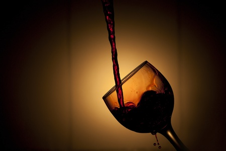 Beautiful image of the Pouring red Wine photo