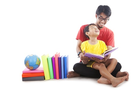 Little, cute boy reading a book with his father photo