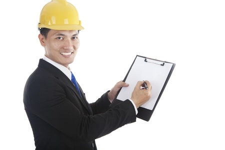 inspecting: A construction safety inspector marking his checklist