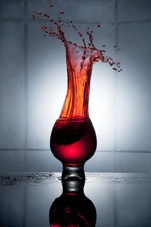 alcoholic beverage: Splashing strawberry into a glass of drink