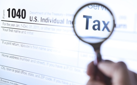 An investigate of tax form 1040 Stock Photo - 12237495