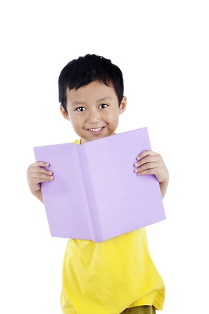 elementary school student: Smiling adorable boy reading a book, shot in studio isolated on white