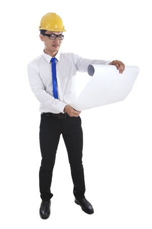 asian architect: Construction project architect checking the blueprints on white background