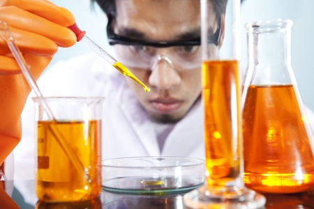 A scientist doing a biotechnology research in the laboratory research Stock Photo - 12652393