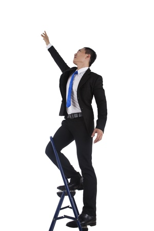 reaching hand: Side view of a businessman climbing a ladder, isolated on a white background.