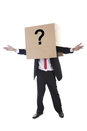 asking question: Businessman with question mark sign on the box