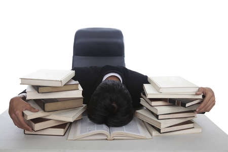 Businessman exhausted and sleep on open book photo
