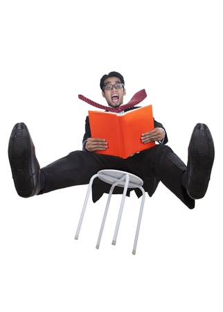 Asian businessman falling from a chair on white photo