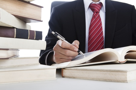 Businessman writing on a book Stock Photo - 12721365