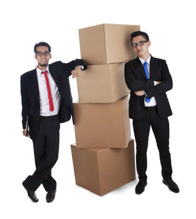 Businessmen with packed cardboard boxes over a white background photo