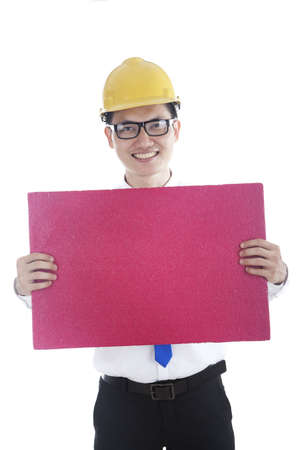 Male engineer with a banner isolated over a white background photo