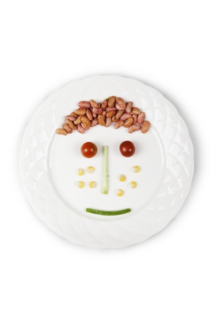 breakfast smiley face: A face made of different vegetables on plate Stock Photo