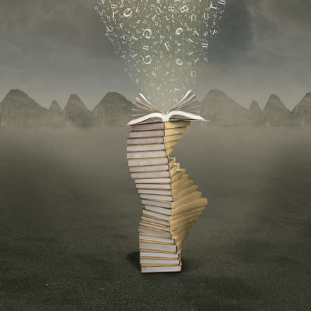 guidebook: Open book with falling letters into the pages over mountains background Stock Photo