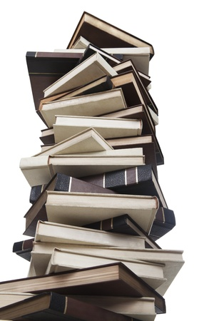 High stack of books shot in studio isolated on white background photo