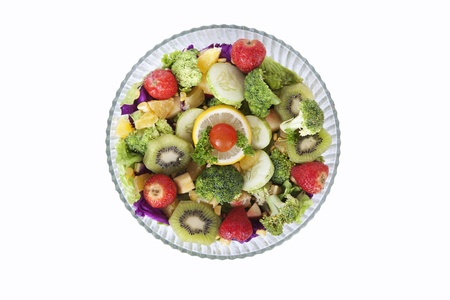 A fresh salad made of fruits and vegetables in the bowl, isolated on white photo