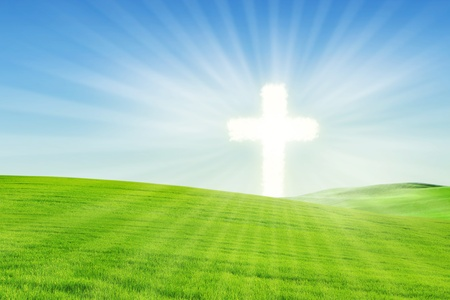 cross light: Christian background: Cross standing on a beautiful meadow Stock Photo