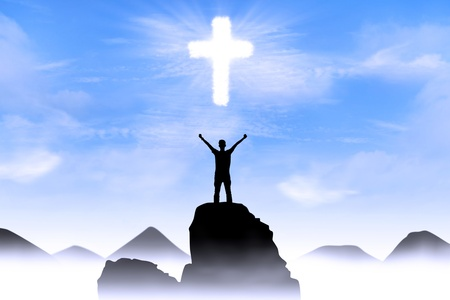 glory: Silhouette of a man with arms stretched out to the cross glowing in the sky. Stock Photo