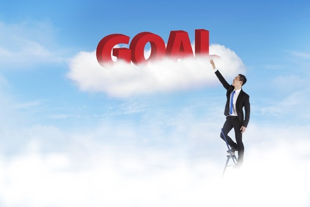 Businessman climbing ladder to achieve his goal photo