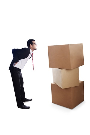 Businesspeople tired to move the stack of cardboard photo