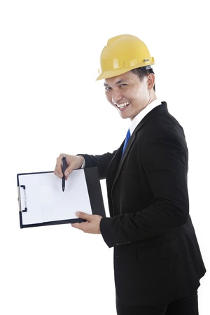 Happy engineer showing blank clipboard, isolated on white photo