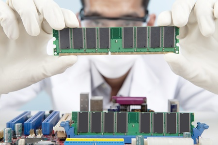 A scientist checking the memory card of motherboard Stock Photo - 12652614