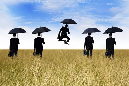 Business success: businessman jumping in front of his team Stock Photo - 13004306