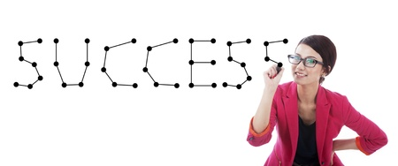 connect the dots: Businesswoman connecting the dots making the word success