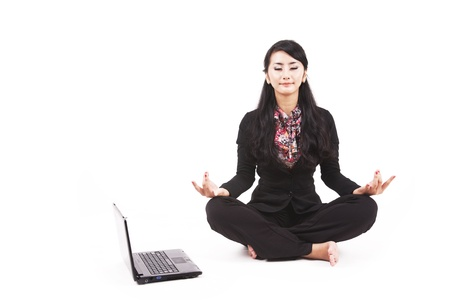 Asian businesswoman meditating shot in studio isolated on white photo