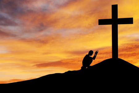 confession: Christian background: Silhouette of man praying under the cross at sunsetsunsrise