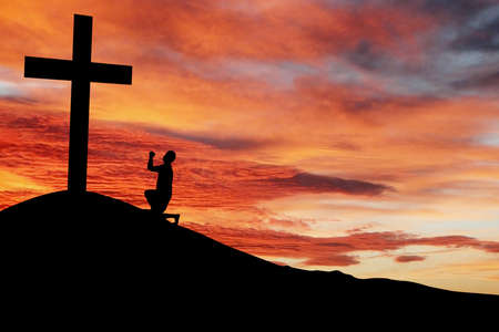 confession: Christian background: Silhouette of a man praying by the cross at sunrise or sunset Stock Photo