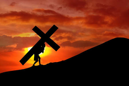 calvary: The figure of Jesus Christ carrying the cross up Calvary on Good Friday.  Stock Photo