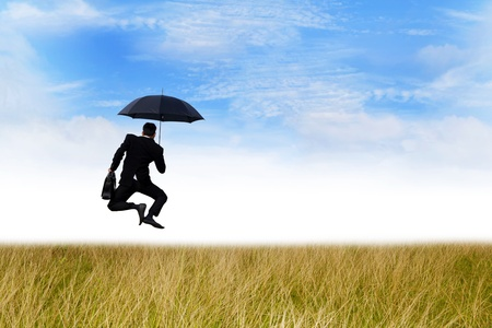 Happiness of agent jumping on the meadow with umbrella photo